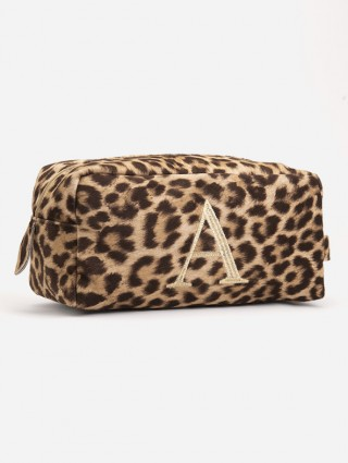 Spotted fabric beauty case with gold Times letter font embroidery