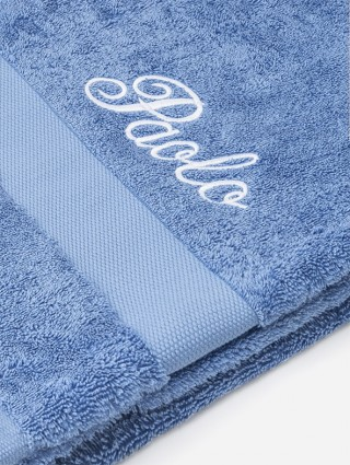 Periwinkle terry towel with italic font embroidery
